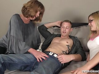 Three lucky guy enjoys while two sluts stroke added to suck his penis