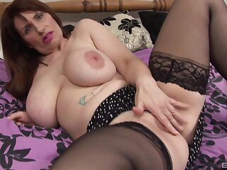 Mature brunette with saggy tits strips together with gets dirty on the bed