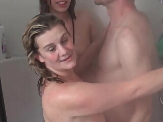 Wet amateur babes sharing played cock in shower