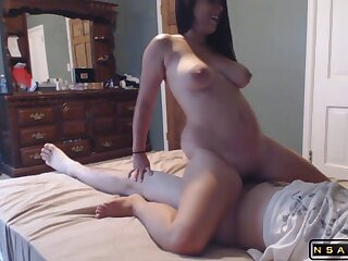 Horny milf with big gut enjoys a profligate fucking on the bed