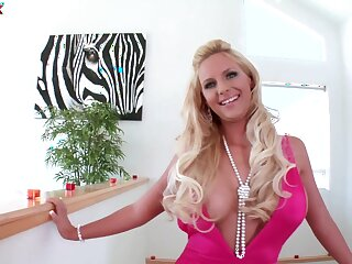 Solo pornstar Phoenix Marie puts her dildo all round her mouth and pussy