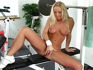 Milf rubs pussy vanguard gym on touching a sexy solo