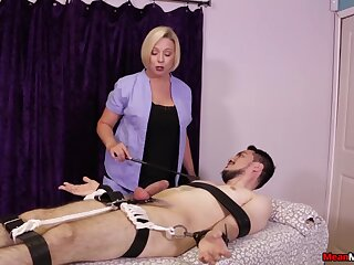 Strict blonde masseuse gives a Femdom handjob to a bounce buyer