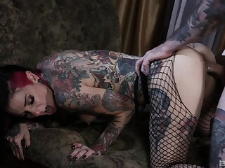 Tattooed couple having nasty sexual connection on the bed with facial grand finale