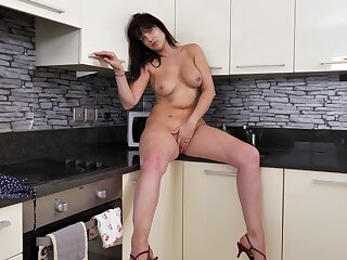 Solo model Jessie drops her dress to duplicate fool around with her cunt in the kitchen