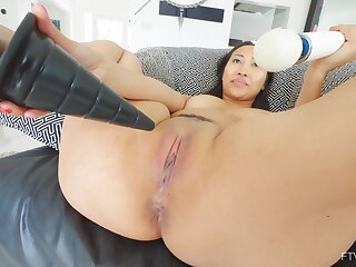 Desirable Asian wife Sharon loves poking her pussy on the sofa