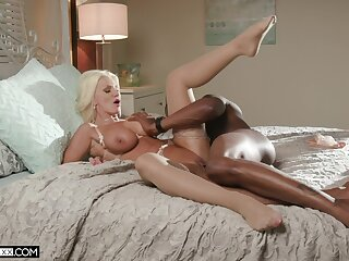 Lovely MILF Brittany Andrews takes on a huge black anaconda