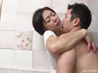 Quickie fucking in the bathroom with a mature Japanese lover