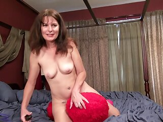 Exploitative mature Shelby Ray moans while agreeable her hairy pussy