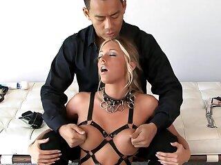 Blonde Samantha Saint in leather bondage - boobs tortured in fetish chapter