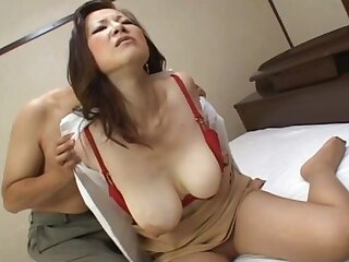 Busty Japanese babe lays on the bed increased by moans during fucking
